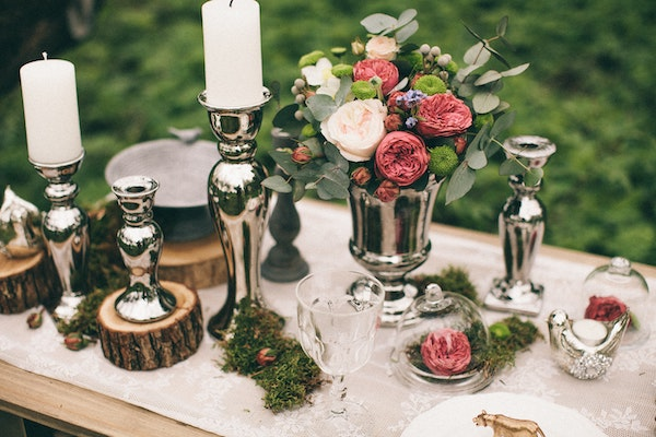 rustic wedding table centrepiece in Auckland with wood and silver